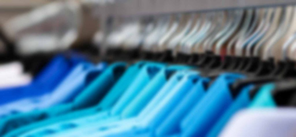shirts-hanging-neatly-in-closet